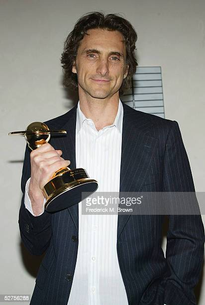 Lawrence Binder poses with trophy after being honored during the 31st Annual Saturn Awards at the Universal Hilton Hotel on May 3 2005 in Los Angeles...