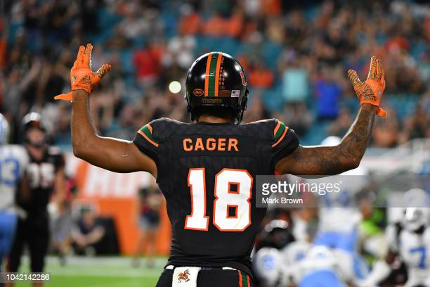 Lawrence Cager of the Miami Hurricanes gestures in the fourth quarter at Hard Rock Stadium on September 27 2018 in Miami Florida