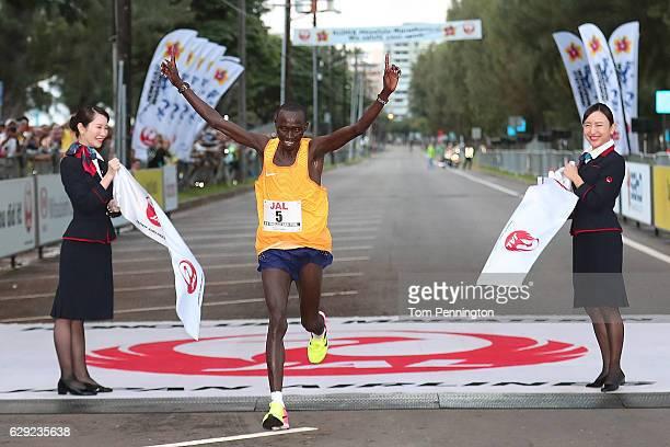 Lawrence Cherono of Kenya crosses the finish line during the Honolulu Marathon 2016 on December 11, 2016 in Honolulu, Hawaii.