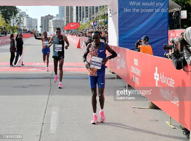 Lawrence Cherono of Kenya finishes in front of Dejene Debela of Ethiopia and Asefa Mengstu of Ethiopia on during the 2019 Bank of America Chicago...