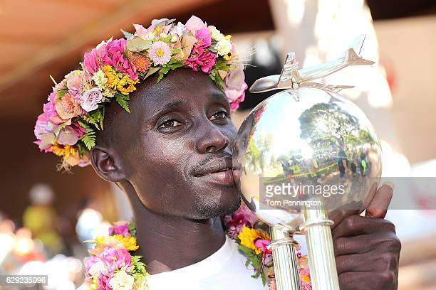 Lawrence Cherono of Kenya poses with his trophy in winners' ceremony after the Honolulu Marathon 2016 on December 11, 2016 in Honolulu, Hawaii.
