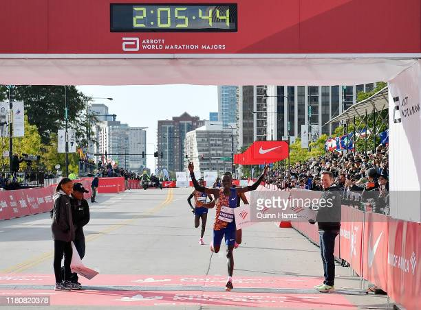 Lawrence Cherono of Kenya wins the men's race past Dejene Debela of Ethiopia during the 2019 Bank of America Chicago Marathon on October 13 2019 in...