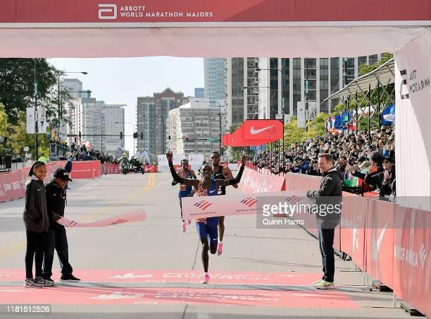 Lawrence Cherono of Kenya wins the men's race past Dejene Debela of Ethiopia during the 2019 Bank of America Chicago Marathon on October 13, 2019 in...