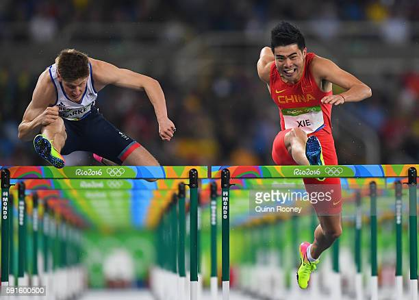 Lawrence Clarke of Great Britain and Wenjun Xie of China compete during the Men's 110m Hurdles Round 1 on Day 10 of the Rio 2016 Olympic Games at the...
