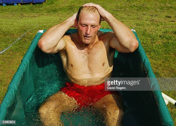 Lawrence Dallaglio of England relaxes in an ice bath during England Rugby Union training held on August 6 2003 at the Pennyhill Park Hotel in Bagshot...