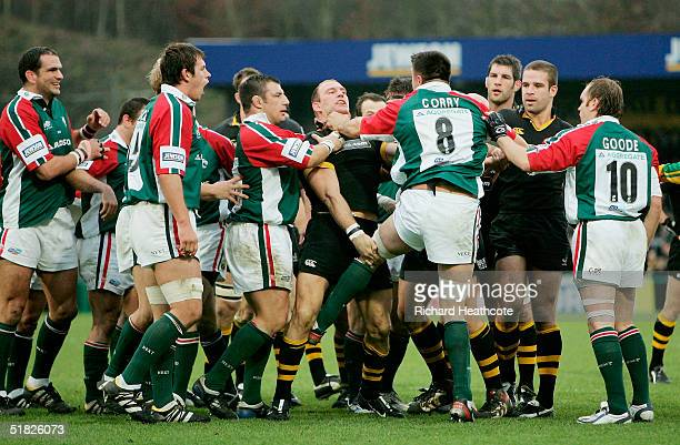 Lawrence Dallaglio of London Wasps is grabbed by the throat by Martin Corry of Leicester Tigers during the Heineken Cup match between London Wasps...