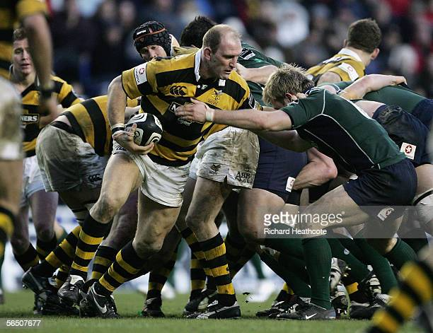 Lawrence Dallaglio of Wasps is challenged by Richard Thorpe of Irish during the Guinness Premiership match between London Irish and London Wasps at...