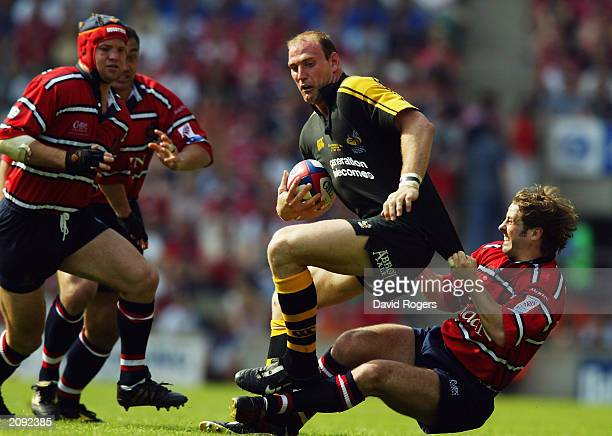 Lawrence Dallaglio of Wasps is hauled down by Andy Gomarsall of Gloucester during the Zurich Premiership Final between Gloucester and London Wasps on...