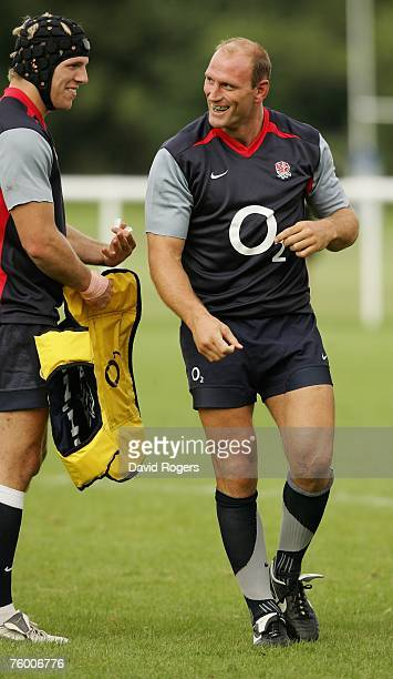 Lawrence Dallaglio shares a joke with team mate James Haskell during the England training session held at Bath University on August 7 2007 in Bath...