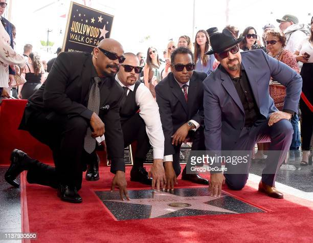 Lawrence 'DJ Muggs' Muggerud Louis 'BReal' Freese Senen 'Sen Dog' Reyes and Eric 'Bobo' Correa of Cypress Hill pose at their Star on The Hollywood...