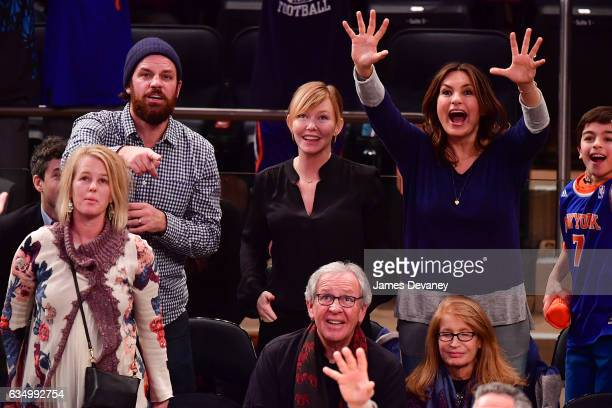 Lawrence Faulborn Kelli Giddish and Mariska Hargitay attend the San Antonio Spurs Vs New York Knicks game at Madison Square Garden on February 12...