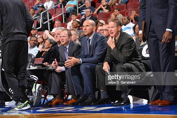 Lawrence Frank and Jason Kidd of the Brooklyn Nets sit on the bench against the Philadelphia 76ers at the Wells Fargo Center on October 14 2013 in...