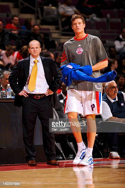 Lawrence Frank head coach of the Detroit Pistons talks to player Jonas Jerebko during a game against the Charlotte Bobcats on February 29 2012 at The...