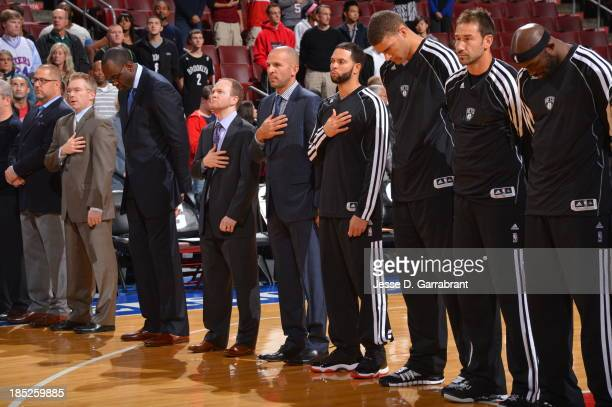 Lawrence Frank Jason Kidd Deron Williams Brook Lopez Marko Jaric and Reggie Evans of the Brooklyn Nets stand on the court before the game against the...