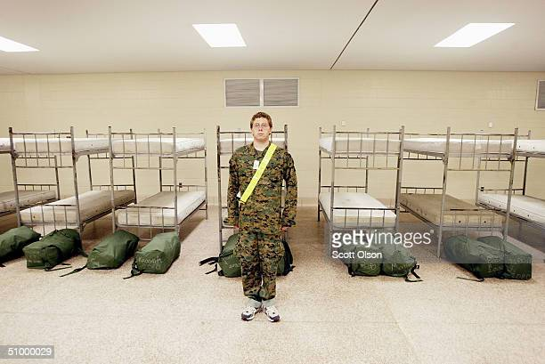 Lawrence Goetz of Reevesville South Carolina stands at attention in an empty barracks shortly after arriving at the United States Marine Corps...