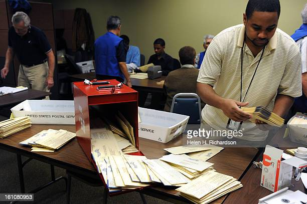 Lawrence Goshon takes mailin ballots out of the red collection boxes He and other election officials were preparing the received mail in ballots to...