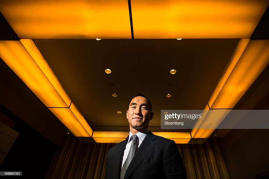 Lawrence Ho, co-chairman and chief executive officer of Melco Crown Entertainment Ltd., stands for a photograph in Manila, the Philippines, on Wednesday, Oct. 9, 2013. Ho said gambling revenue in the Philippines 'could easily' double to $4 billion in a couple of years, setting the stage to challenge Singapore as Asia's second-biggest gaming hub. Photographer: Julian Abram Wainwright/Bloomberg via Getty Images