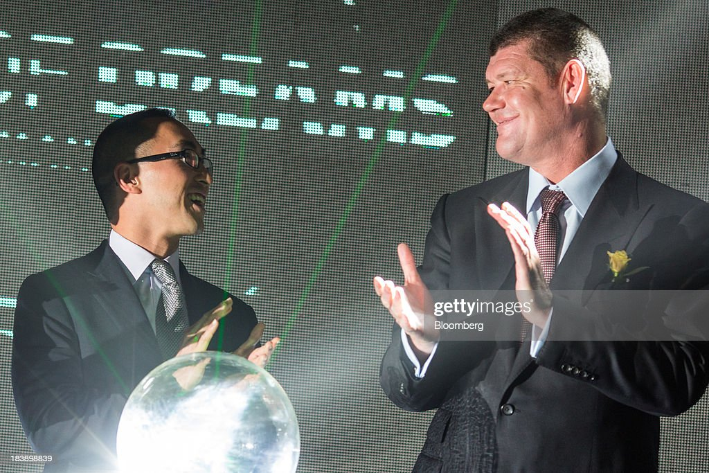 Lawrence Ho, co-chairman and chief executive officer of Melco Crown Entertainment Ltd., left, and James Packer, co-chairman of Melco Crown Entertainment Ltd. and chairman of Crown Ltd., applaud during a news conference in Manila, the Philippines, on Wednesday, Oct. 9, 2013. Ho said gambling revenue in the Philippines 'could easily' double to $4 billion in a couple of years, setting the stage to challenge Singapore as Asia's second-biggest gaming hub. Photographer: Julian Abram Wainwright/Bloomberg via Getty Images