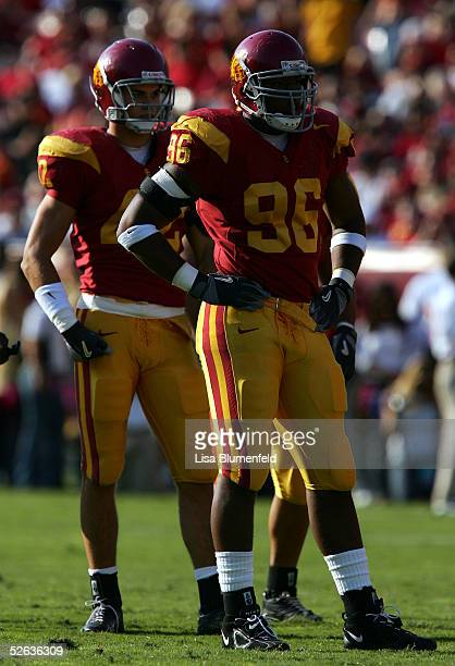 Lawrence Jackson of the University of Southern California Trojans and teammate Dallas Sartz look on against the Washington Huskies on October 23,...