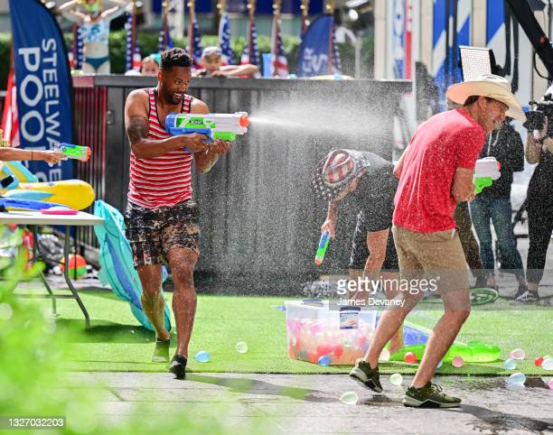 Lawrence Jones and Will Cain celebrate Independence Day on 'Fox & Friends Weekend' on July 04, 2021 in New York City.