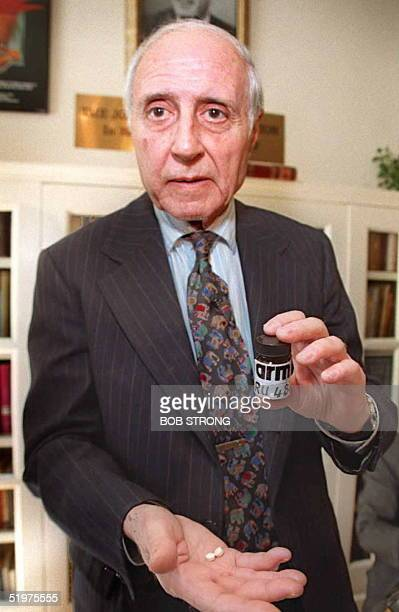 Lawrence Lader, president of Abortion Rights Mobilization holds a US made copy of RU 486, the French abortion pill, 13 March during a press...