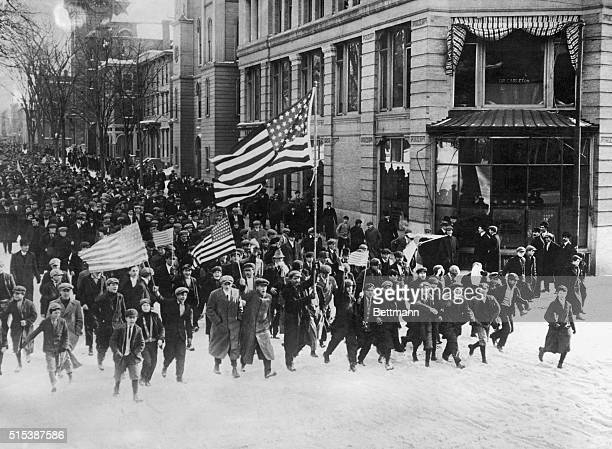 Lawrence MA Picture shows Striking workers walking to attack the mill Undated photo