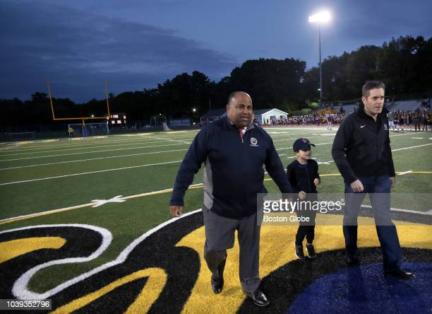 Lawrence Mayor Dan Rivera arrives at the middle of the field for the coin toss for the Lawrence High School and Andover High School football game as...