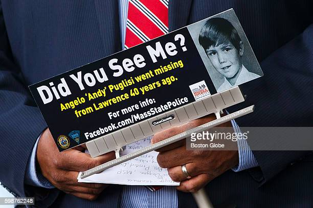 Lawrence Mayor Dan Rivera holds a sign of Angelo Andy Puglisi at a press conference to commemorate the passage of 40 years since the abduction of the...