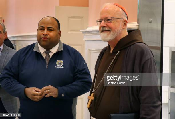 Lawrence Mayor Dan Rivera left and Cardinal Sean O'Malley walk together into the Cor Unum Meal Center in Lawrence MA where the volunteer staff serves...