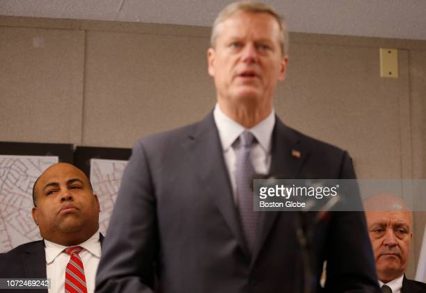 Lawrence Mayor Dan Rivera left and North Andover town manager Andrew Maylor right listen as Massachusetts Governor Charlie Baker speaks at a press...