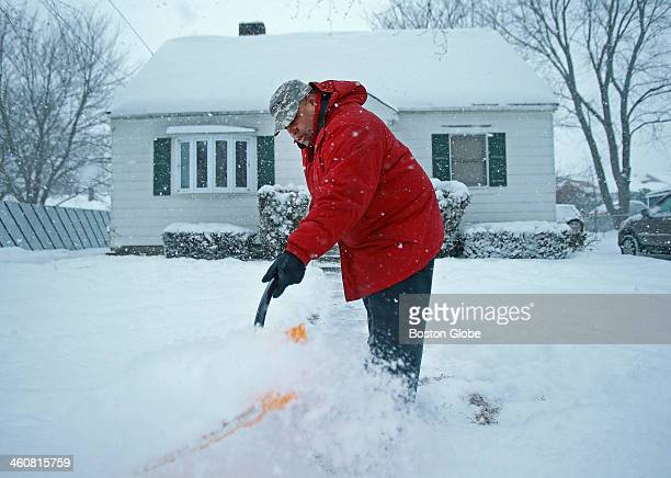 Lawrence mayorelect Daniel Rivera shovels snow at his home on Thursday afternoon as a winter storm covered Massachusetts