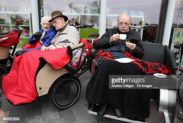 Lawrence Moffat enjoys a cup of tea with Mary Duncan and Jim Taylor at the Helix Park where Public Health and Sport Minister Aileen Campbell launched...