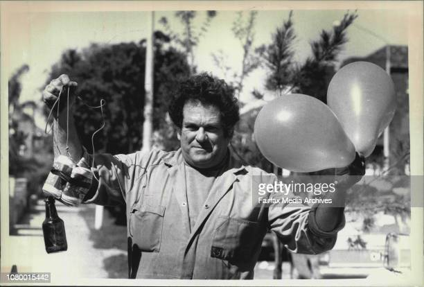 Lawrence Ocrame auto electrician from Bondi demonstrates how louts at Henson park are trying to send balloons carrying beer bottles and cans up into...