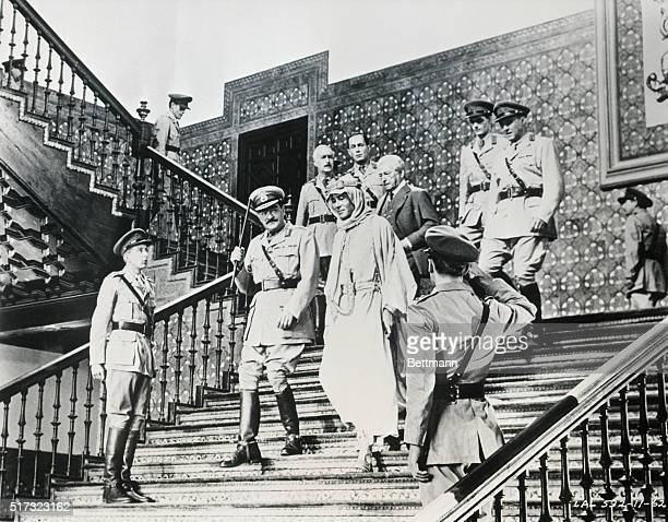 TE Lawrence of Arabia descends the stairs at GHQ with his commander General Allenby Mr Dryden of the Foreign Office and Colonel Harry Brighton in...