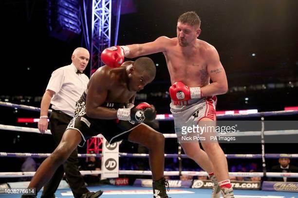 Lawrence Okolie and Matty Askin duiring their British cruiserweight title fight at Wembley Stadium London