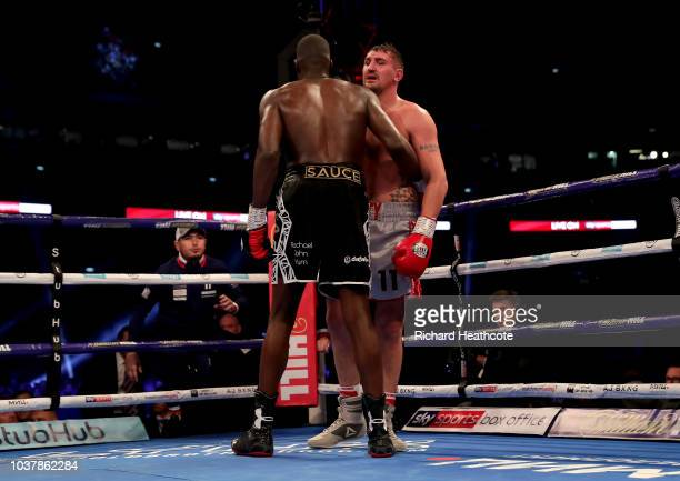 Lawrence Okolie and Matty Askin embrace after the British Cruiserweight Championship title fight between Matty Askin and Lawrence Okolie at Wembley...