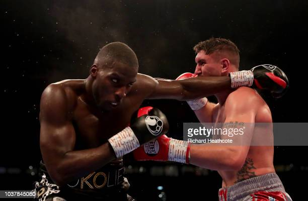 Lawrence Okolie and Matty Askin exchange punches during the British Cruiserweight Championship title fight between Matty Askin and Lawrence Okolie at...