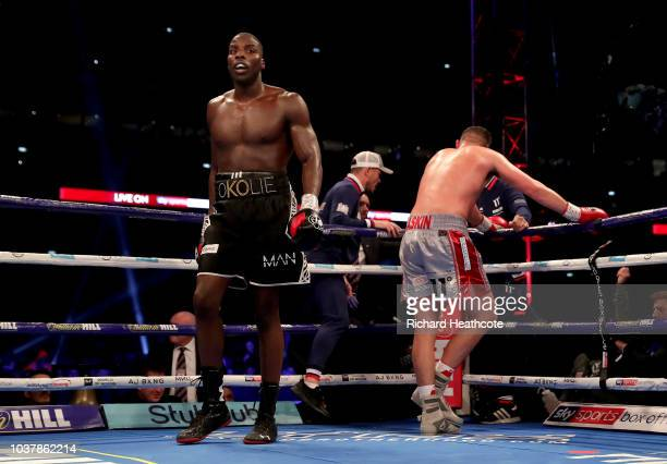 Lawrence Okolie and Matty Askin react after the British Cruiserweight Championship title fight between Matty Askin and Lawrence Okolie at Wembley...