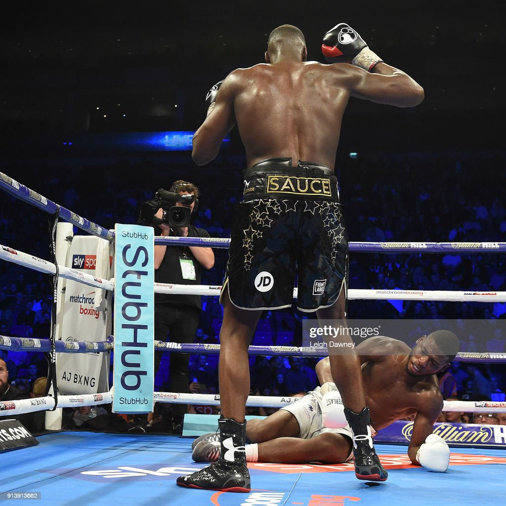Lawrence Okolie knocks down Issac Chamberlain during their fight for the vacant WBA Continental Cruiserweight title at The O2 Arena on February 3, 2018 in London, England.