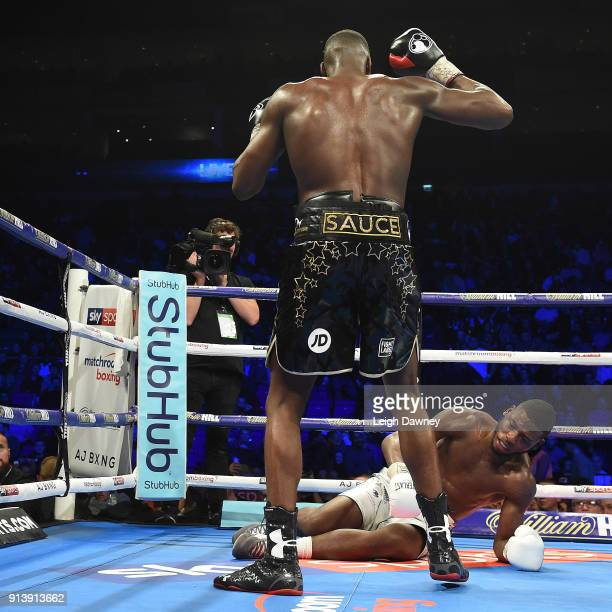 Lawrence Okolie knocks down Issac Chamberlain during their fight for the vacant WBA Continental Cruiserweight title at The O2 Arena on February 3...