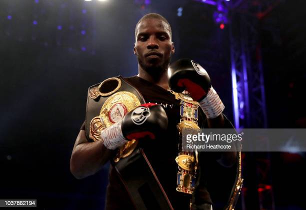 Lawrence Okolie poses with the British Cruiserweight Championship belt after victory in the British Cruiserweight Championship title fight between...