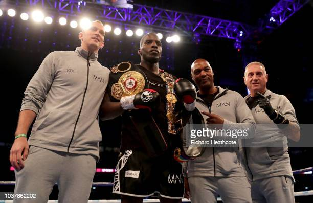 Lawrence Okolie poses with the British Cruiserweight Championship belt and his team after victory in the British Cruiserweight Championship title...