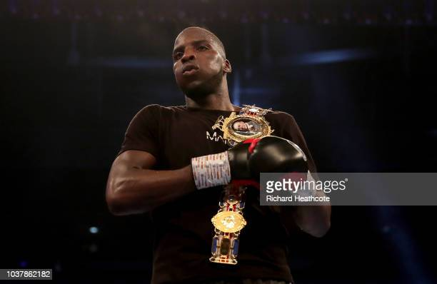 Lawrence Okolie reacts with the British Cruiserweight Championship belt after victory in the British Cruiserweight Championship title fight between...