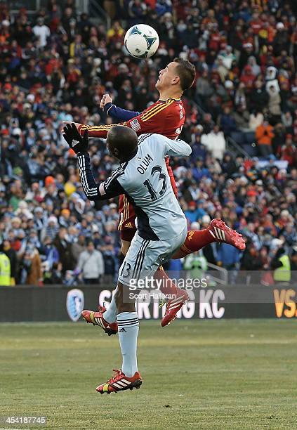 Lawrence Olum of Sporting KC batlles for the ball against Luis Gil of Real Salt Lake in the first half of the 2013 MLS Cup at Sporting Park on...