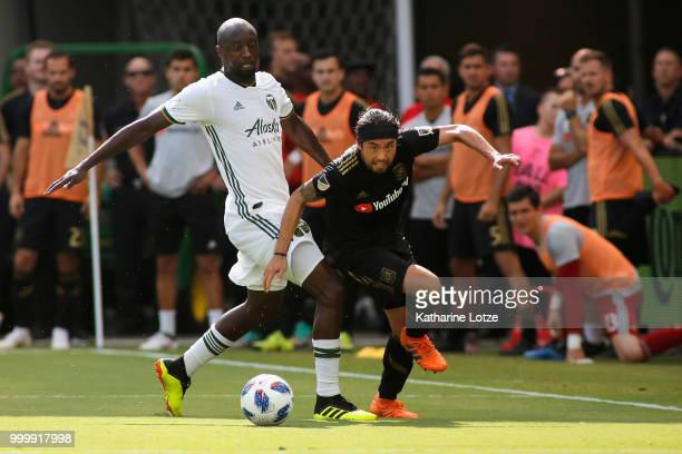 Lawrence Olum of the Portland Timbers and Lee Nguyen of the Los Angeles Football Club battle for control of the ball at Banc of California Stadium on...