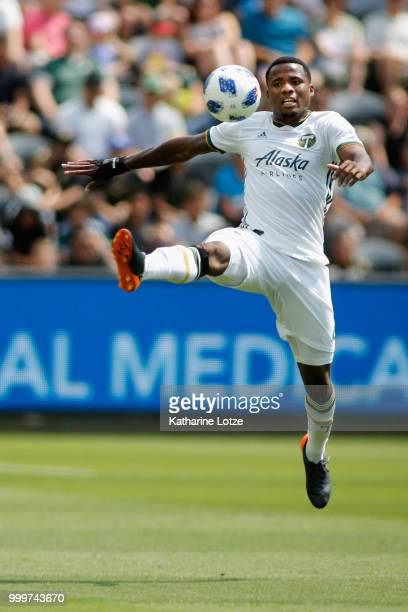Lawrence Olum of the Portland Timbers looks on as goalkeeper Jeff Attinella of the Portland Timbers reaches for a save after Lee Nguyen of the Los...