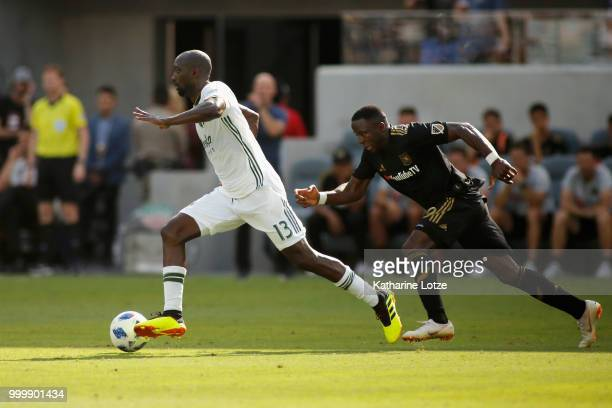 Lawrence Olum of the Portland Timbers moves the ball against Adama Diomande of the Los Angeles Football Club at Banc of California Stadium on July 15...