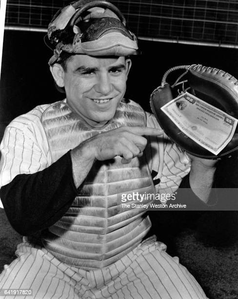 Lawrence Peter Berra Yogi Berra shows off his $25 dollar Savings Bond made out to Yogi Berra New York Yankees Yogi often helped to support sell...