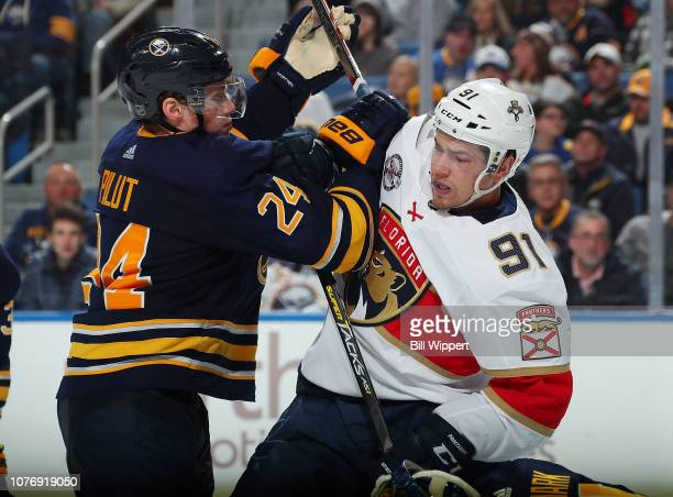 Lawrence Pilut of the Buffalo Sabres defends against Juho Lammikko of the Florida Panthers during an NHL game on January 3, 2019 at KeyBank Center in...
