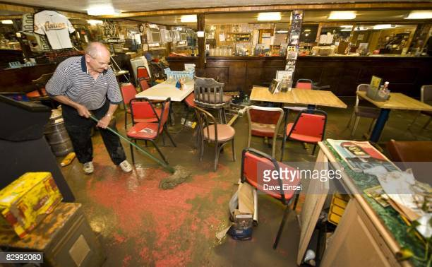 Lawrence Puccetti mops up mud from his restaurant that was damaged from Hurricane Ike September 24 2008 in Galveston Texas City officials are...